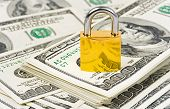 Money and lock - business security background