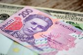 Dollars Euro And Hryvnia Banknotes On Wooden Background