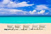 Chairs on tropical beach - abstract vacations background