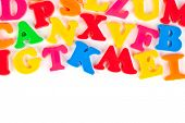Multicolored toy letters isolated on white background