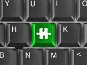 Computer keyboard with puzzle key - business background
