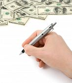 Hand with pen and money isolated on white background