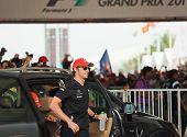 SEPANG, MALAYSIA - APRIL 10: Jenson Button (team McLaren Mercedes) greet fans at the autograph session on Formula 1 GP, April 10 2011, Sepang, Malaysia