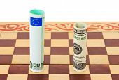 Dollar and euro on chess board - business concept background