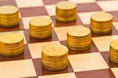 Money on chess board - concept business background