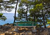 Coast, bench and sea at Brela, Croatia - vacations background