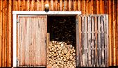 Old Wooden Barn With Firewood