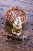 image of flax seed oil  - Flax seeds oil on wooden background - JPG