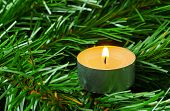 Candle and christmas tree - abstract holiday background