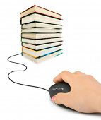 Hand with computer mouse and books - e-learning concept