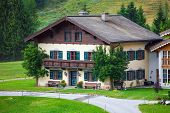 A Beautiful Typical Mountain Guests House On Austrian Alps