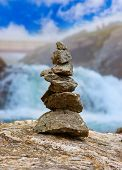 Stigfossen waterfall and stones stack in Norway - nature and travel background