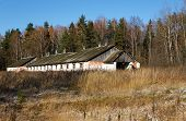 rusting broken down farm house on rural Russia