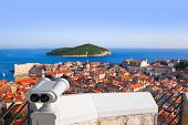 Binoculars and Dubrovnik in Croatia - abstact travel background