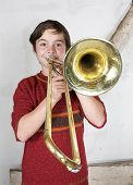 pic of trombone  - portrait of a boy playing the trombone - JPG