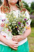 Woman holding wild flowers
