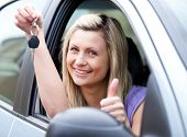 Lively Female Driver Showing A Key After Bying A New Car