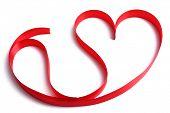 Heart shaped shiny red satin ribbon isolated on white