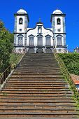 Sights of the Portuguese island of Madeira. Magnificent white church of Nossa-Senior-du-Monty. To the building the long picturesque ladder conducts
