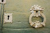 stock photo of wooden door  - Lock and knocker of an old wooden door - JPG