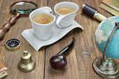 picture of spyglass  - Earth Globe Vintage Spyglass Magnifying Glass Compass Two Notebooks Smoking Pipe and Two Espresso Coffee Cups On The Grunge Wooden Table - JPG