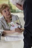 stock photo of divorce-papers  - Senior woman wants to divorce with husband after his betrayal - JPG