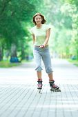 image of inline skating  - Roller skating sporty girl in park rollerblading on inline skates - JPG