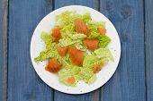 Salad With Smoked Salmon On White Plate