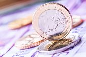picture of coins  - Several 500 euro banknotes and coins are adjacent - JPG