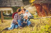 stock photo of threesome  - Young family - JPG