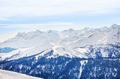 pic of caucus  - Winter landscape of magnificent Caucasus mountains during daytime in Sochi ski resort Krasnaya polyana - JPG