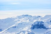 foto of caucus  - Winter landscape view of Caucasus mountains during daytime in Sochi ski resort Krasnaya polyana - JPG