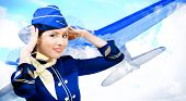 picture of air hostess  - Beautiful smiling stewardess on a background of a flying airplane - JPG