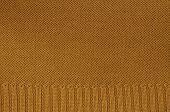 picture of knitting  - close up of a rust colored knitted background pattern, knitted right and left, detail, full frame ** Note: Visible grain at 100%, best at smaller sizes - JPG