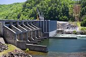 pic of hydro  - Shot of a hydro electricity generating plant along a mountain - JPG
