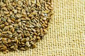 stock photo of flax seed oil  - Close up of flax seeds on top of textured surface - JPG