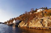 pic of fjord  - Wooden houses on the steep bank of the fjord - JPG