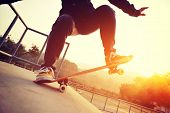 picture of skateboarding  - young skateboarder practice skateboarding at skatepark ramp - JPG