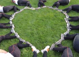 stock photo of fastpitch  - A fastball team created a heart shape using their cleats - JPG