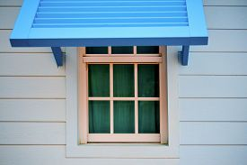 stock photo of jalousie  - Blue wood jalousie and wood window in natural light - JPG