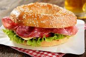 stock photo of bagel  - Bagel sandwich with sausage - JPG