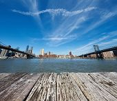 image of brooklyn bridge  - Manhattan skyline view from Brooklyn between Brooklyn Bridge and Manhattan Bridge in New York City - JPG