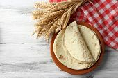 foto of whole-wheat  - Stack of homemade whole wheat flour tortilla on plate - JPG
