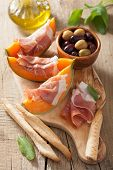 picture of cantaloupe  - cantaloupe melon with prosciutto grissini olives - JPG