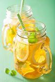foto of mason  - ice tea with lemon and melissa in mason jars - JPG