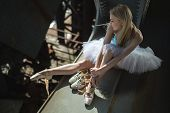 picture of tutu  - Ballerina sitting on the edge of the bridge - JPG