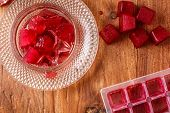 picture of sorrel  - Frozen hibiscus tea also known as karkade agua fresca or red sorrel on a wooden table - JPG