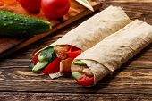 stock photo of shawarma  - Traditional shawarma wrap with chicken and vegetables near its ingredients - JPG