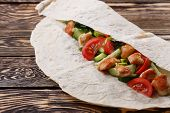 foto of shawarma  - Traditional shawarma wrap with chicken and vegetables - JPG
