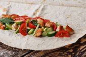 image of shawarma  - Traditional shawarma wrap with chicken and vegetables - JPG